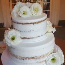 Photo for Porto's Bakery Review - Semi-naked Cuban cake w/pineapple fill. Flowers by others.