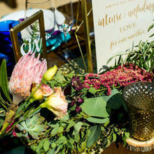 Photo of ADORNMENTS flowers & finery in San Luis Obispo, CA - Table garland and candles