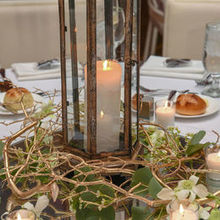 Photo of Carl Alan Floral Designs Ltd. in Philadelphia, PA - Table 1: Lanterns, branches, candles, and buds