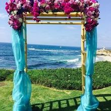 Photo of Camellia Wedding Flowers in San Diego, CA - Bamboo arch
