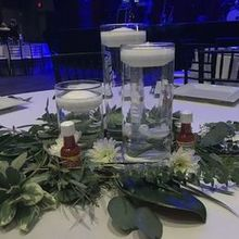 Photo of Stephanie's Secret Garden in Poolesville, MD - centerpieces using our vases & candles