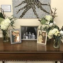 Photo of Stephanie's Secret Garden in Poolesville, MD - extra vases at church w/ family photos