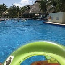 "Photo for Paradise Getaways Review - The main ""party pool"""