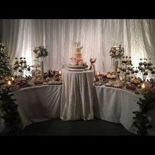 Photo for Prime Time Party Rental Review - Winter White Sparkle Drape and Table Cloth set the Desserts!