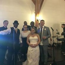 Photo for Dave Macklin Band Review - us with DMB at the end of our wedding!