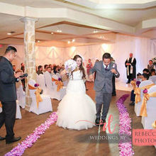 Photo for JPC Mobile DJ Service Review - Bride and the Groom grooving to the music down the aisle.