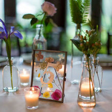 Photo of Fleur De Lis Florist in Baltimore, MD - fun vases that FDL provided as rentals