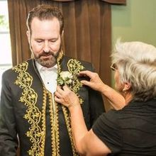 Photo of D & D Floral Design in Los Osos, CA - Sweet Debbie assisting my husband with his boutonniere.