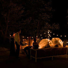 Photo of Red Barn 20 at Windridge Estate in Cazenovia, NY - Night lighting on patio and umbrellas for a light sprinkle