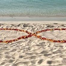 Photo of Flawless Weddings & Events of the Virgin Islands in St Thomas, VI - infinity symbol sand altar in rose petals