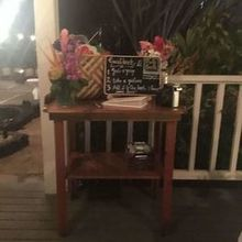 Photo for Plantation Gardens Restaurant & Bar Review - 'Photo booth' table  and guest book table.