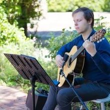 Photo of Christopher Nicklin Guitar in San Jose, CA - Christopher playing at my wedding