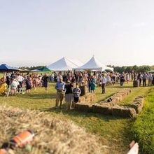 Photo for Party Time Rentals Review - A look from the hayride cart, smaller white tent is the bar