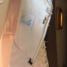 Photo for Bijou Bridal & Special Occasion Review - We had to sew the eye and hooks on