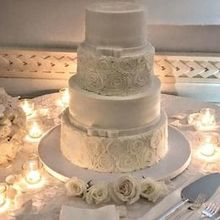 Photo of Butterfly Bakeshop in Long Island City, NY - Our gorgeous wedding cake with rosettes and bows!