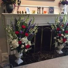 Photo for Suzanne's Flowers Review - The alter arrangements that were also used at the reception.