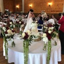 Photo for SFS Weddings & Events, LLC, Swannanoa Flower Shop Review - Bridesmaids' bouquets around the cake table