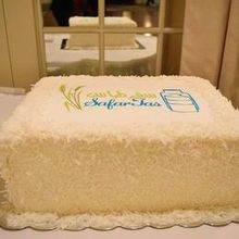 Photo of Dana's Cake Shoppe in Fairfax, VA - SafarTas cake, filled with fruits and covered with coconut.