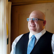 Photo of Crystal Genes Photography in Portland, OR - Groom Getting Ready