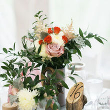 Photo of The Faded Poppy in Waynesboro, VA - Table arrangement with Bride's bouquet