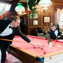 Photo of Rose Hill Plantation in Nashville, NC - Groomsmen shooting pool after getting ready.