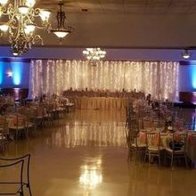 Photo of Reasonable Party Rental, LLC in Richfield, OH - Some of our uplighting and out backdrop!