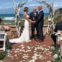 Photo for Harbour House Oceanfront Review - Patio ceremony site at HH and officiant, Jim.