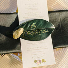 Photo of Ettie Kim Calligraphy & Design in Philadelphia, PA - Our place settings-- names on magnolia leaves.