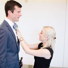 Photo of Nicole George Event Planning & Design in Long Beach, CA - Nicole helping the groom with his boutonnière