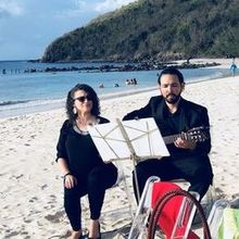 Photo for Allied Music Solutions Review - Guitarist on Flamenco Beach