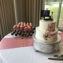 Photo for Top Tier Events Review - Carolyn and Meg set up the room, including the cake table