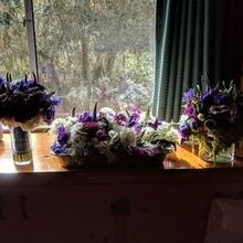 Photo for Sweeley's Design Shop Review - Sorry about the backlighting. L: bridal bouquet, R: centerpc