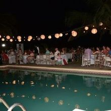 Photo for The Wedding Planner Plus Review - Set up around the pool. The lanterns were a perfect touch!