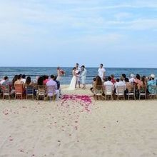 Photo for The Wedding Planner Plus Review - A simple ceremony on the beach with petals.