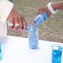 Photo for Performing the Wedding Review - Three Colors of sand poured into one glass container.
