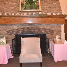 Photo of ANNA ROSE FLORAL & EVENT DESIGN in Haledon, NJ - Beautiful Secret Garden Roses added to the fireplace.